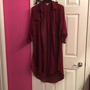 This is a long sleeve burgundy shirt dress.